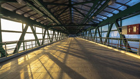 Steel pedestrian bridge overpasses highway. Steel  and glass pedestrian bridge overpasses highway Royalty Free Stock Photography