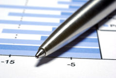 Steel pen macro. Financial concept. Steel pen macro on printed report with diagramm. Financial concept Royalty Free Stock Image