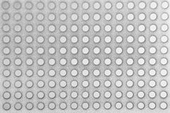 Steel perforated metallic background Stock Image