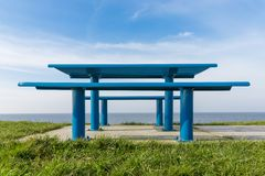 Steel picnic table at Dutch coast Royalty Free Stock Photo