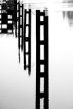 Steel piers in the water Royalty Free Stock Photos