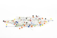Steel pins. Handful of steel pins with colorful heads isolated on white Royalty Free Stock Photo