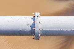 Steel pipe connection in heavy industry. Royalty Free Stock Photography