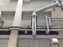 The steel pipe from cooling Tower Pumping. The steel pipe from cooling Tower Pumping and Piping install at the outside of building Royalty Free Stock Image