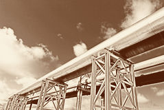 Steel pipe-line is photographed on sky background stock images