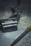 Steel pipe products and metal file on a working table. Vertical Royalty Free Stock Image