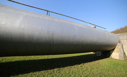 Steel pipe for the transport of gas or oil in the laying stage. Huge steel pipe for the transport of gas or oil in the laying stage Royalty Free Stock Photography