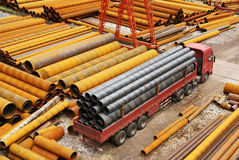 Steel pipe with truck Stock Images