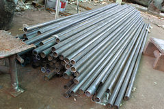 Steel pipe. Pipe is a tubular section or hollow cylinder, usually but not necessarily of circular cross-section, used mainly to convey substances which can flow Stock Photography