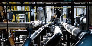 Steel pipelines and cable in a plant Royalty Free Stock Photos