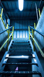 Steel pipelines and staircase in a plant Stock Images