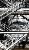 Steel pipelines and staircase in a plant Royalty Free Stock Photos