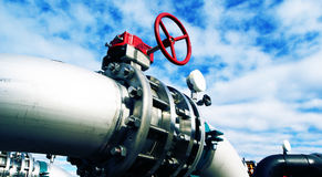 Steel pipelines and valves against blue sky Stock Photography