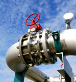 Steel pipelines and valves against blue sky Stock Image