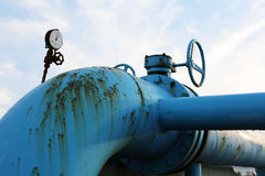 Steel pipelines and valves against blue sky Royalty Free Stock Image