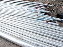 Steel Pipes. Stack of steel pipes on ground at a construction site Stock Image