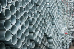 Steel pipes. Piles of steel pipes outdoor stock images