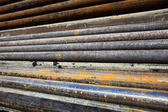 Steel pipes. Wide angle of a pile of rusty steel pipes Stock Images