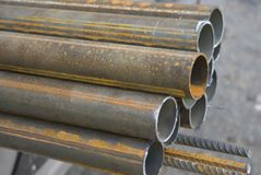 Steel pipes. Some steel pipes. Traces of a rust are visible. The Most part of pipes is sawn off recently (a pure cut Royalty Free Stock Images