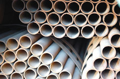 Steel pipes. Abstract close up of a stack of steel pipes Stock Image
