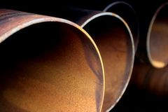Steel pipes abstract. An abstract closeup of some large, rusting steel piipes Royalty Free Stock Images