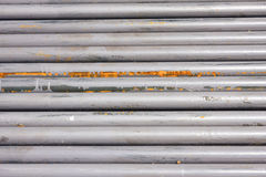 Steel pipes background Stock Images