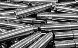 Steel pipes background. Pile of small steel blank pipes - cutted on cnc lathe Stock Photography