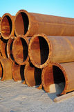 Steel pipes on beach. H to supply sand Stock Images