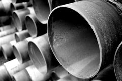 Steel pipes in black and white. A set of large, rusty steel pipes, closeup converted to black and white Royalty Free Stock Images