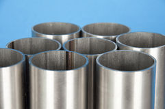Steel pipes. On blue background royalty free stock image