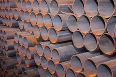 Steel pipes bunch in warehouse royalty free stock photos