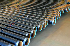 Steel pipes. Closeup of steel pipes line Royalty Free Stock Images
