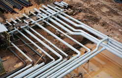 Steel pipes on a newly industrial enterprises Stock Image