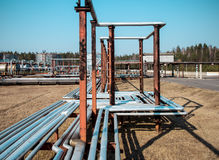Steel pipes at the oil depot Stock Photos