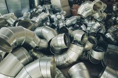 Steel pipes, parts for construction of ducts of industrial air condition system.  Stock Photography