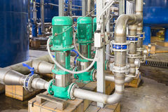 Steel pipes and pumps for water drainage in a power station Stock Photos