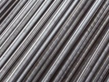Steel pipes and rods laid parallel to diagonal. Industrial abstract background. Royalty Free Stock Photos