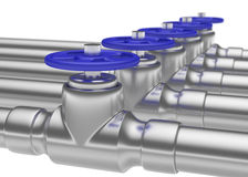 Steel pipes series with blue valves and small DOF Royalty Free Stock Photography