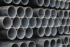 Steel pipes. Stack of steel pipes industrial background Royalty Free Stock Photography