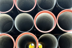 Steel pipes on truck Stock Images