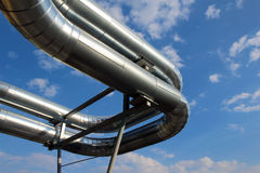 Steel pipes under blue sky in industrial zone Stock Images