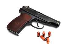 Steel pistol and bullets Stock Images