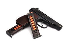Steel pistol and magazines. Steel pistol and two magazines Royalty Free Stock Photo