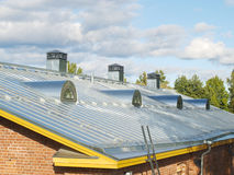 Steel pitched roof. New steel pitched roof with water drain system and air ducts stock image