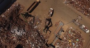 Steel plant area. Scrap heap, unloading of scrap metal factory, view from above, cover shot, metallurgical plant stock footage