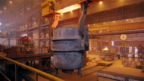 Steel Plant. Crane is Moving Tank with the Liquid Metal stock video