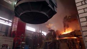 Steel Plant. Crane Transports Empty Scrap Metal Tank stock footage
