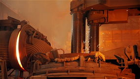Steel Plant. Melting Iron with Sparks. Closeup