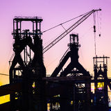 Steel plant in silhouette image at night Stock Photo