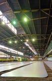 Steel plate on conveyor Royalty Free Stock Photography